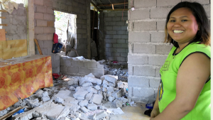Smiling despite the tragedy: Charmaine's visit to their earthquake-destroyed recently constructed house
